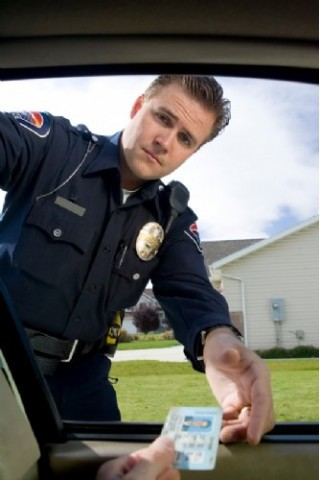 Cop giving traffic ticket