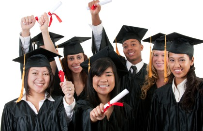 A multi ethnic group of graduates in graduation gowns